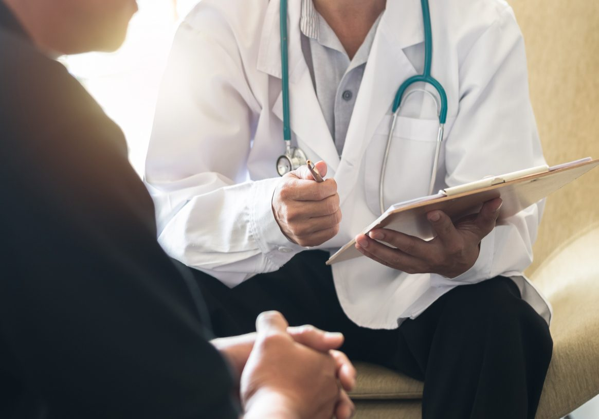 Men's health exam with doctor or psychiatrist working with patient having consultation on diagnostic examination on male disease or mental illness in medical clinic or hospital mental health service